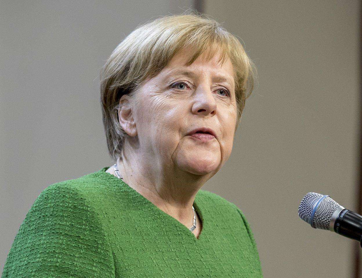 Merkelová uprchlíci dotace